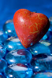 Red heart shape on blue crystals Royalty Free Stock Images
