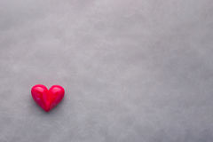 Red heart shape with bow on black gray background. Valentine`s Royalty Free Stock Images