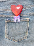 Red heart shape with bow in denim pocket Royalty Free Stock Photo