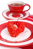 Red in heart shape cake and tea Stock Photos