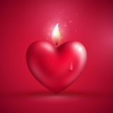 Red heart shape candle on pink background Royalty Free Stock Image