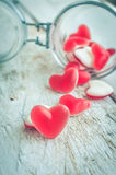 Red heart shape candy in a glass jar Stock Photo