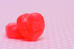 Red heart shape candy on pink Stock Image