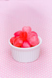 Red heart shape candy on pink Royalty Free Stock Photography