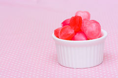 Red heart shape candy on pink Stock Photo