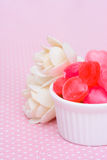 Red heart shape candy on pink Royalty Free Stock Photos