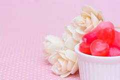 Red heart shape candy on pink Stock Photography