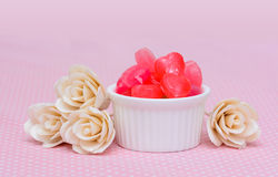 Red heart shape candy on pink Royalty Free Stock Photo