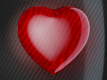 Red heart shape on carbon fiber Royalty Free Stock Photos