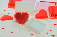 Red heart shape chocolates with present boxes. Royalty Free Stock Images