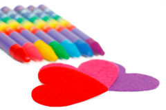 Red heart shape and colored chalks Royalty Free Stock Images