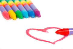 Red heart shape and colored chalks Stock Photography
