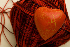 Red heart shape on cotton clew ball Royalty Free Stock Images