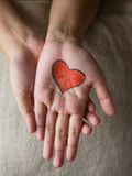 Red heart shape draw on palm. Royalty Free Stock Photos