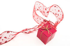 Red heart shape and gift box. A red heart shape made out of red ribbon with hearts and a red gift box, isolated on white background Stock Photos