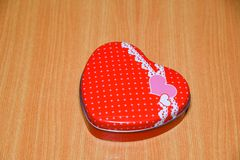 Red Heart shape gift box on wooden table . Valentines Day background , wedding day royalty free stock images
