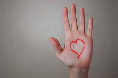 Red Heart Shape on a Hand Royalty Free Stock Image
