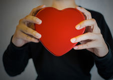 Red heart shape hand holding. Love and romantic Stock Image