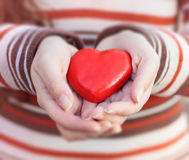 Red Heart Shape In Hands Stock Photos