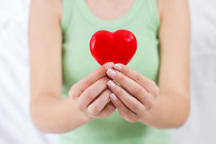 Red Heart Shape Health Love Support. Health Care Love Support Red Heart in female hands Royalty Free Stock Photography