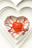 Red heart shape inside iron forms Stock Image