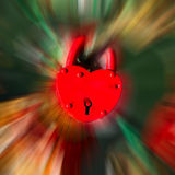 Red heart shape lock on color blurred motion bokeh background. Stock Photos