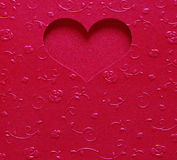 Red heart shape metallic color, card valentine on texture flower Royalty Free Stock Images