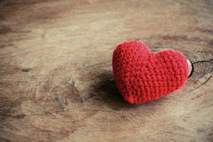 Red heart shape on old wooden background Royalty Free Stock Photography