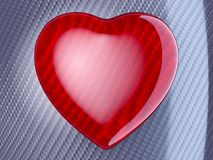 Red heart shape over carbon fibre. Red glossy heart shape over carbon fibre background Stock Photos