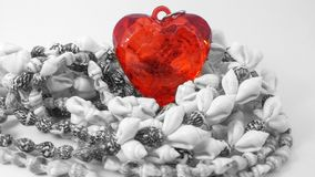 Red heart shape pendants on the black and white Necklace. Made of shells. Only one red Royalty Free Stock Photos