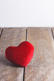 Red Heart Shape pillows on wooden background Royalty Free Stock Photos