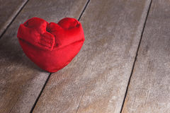Red Heart Shape pillows on wooden background Stock Photos
