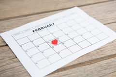 Red heart shape placed on 14th february date of the calendar Stock Photo