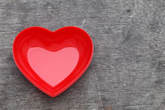 Red heart shape plate. On grunge background stock images