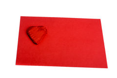 Red heart shape on red sheet of paper. On white background Royalty Free Stock Photography