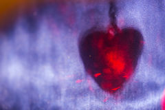 Red heart shape shadow on blue surface, abstract holiday background Stock Photos