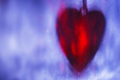 Red heart shape shadow on blue surface, abstract holiday background Stock Image