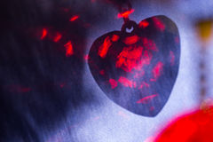 Red heart shape shadow on blue surface, abstract holiday background Royalty Free Stock Photography
