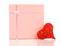Red heart shape symbol made from thread with gift Stock Image