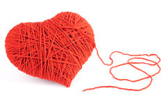 Red heart shape symbol made from wool Stock Images