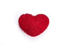 Red heart shape symbol made from wool Royalty Free Stock Photo