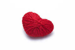 Red heart shape symbol made from wool Royalty Free Stock Images