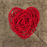 Red heart shape from thread bead Royalty Free Stock Photography