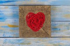 Red heart shape from thread bead Stock Photos