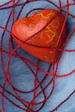 Red heart shape in thread cobweb Royalty Free Stock Photos