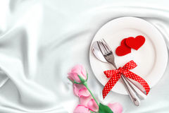 Red heart shape with White empty plate with fork and spoon on Royalty Free Stock Images