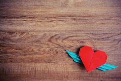 Red heart shape with wings. On wooden table vintage style Stock Photo