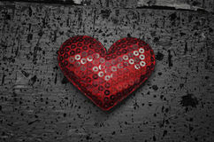 Red heart shape on wood background Stock Image