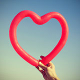 Red heart-shaped balloon Royalty Free Stock Photo