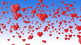 Red heart shaped balloons in the blue sky Stock Image